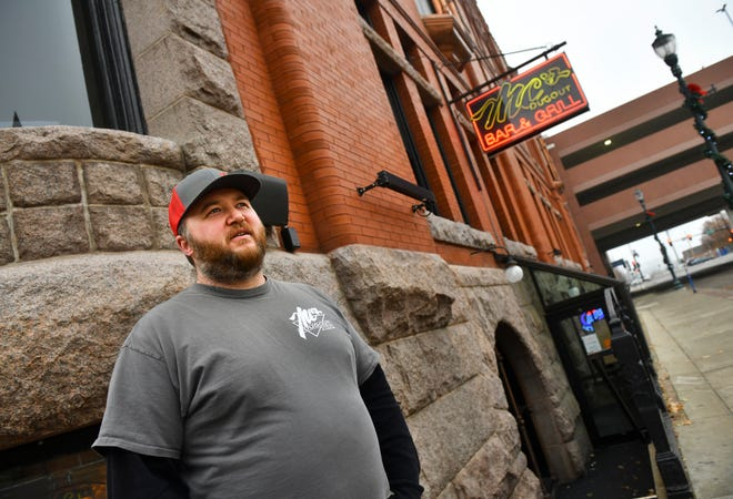 Co-owner Dave Fritz is pictured Monday, Dec. 7, 2020, at MC's Dugout Bar and Grill in St. Cloud. The bar will serve as a collection point for Clothes, toys and food while closed due to COVID-19 restrictions.