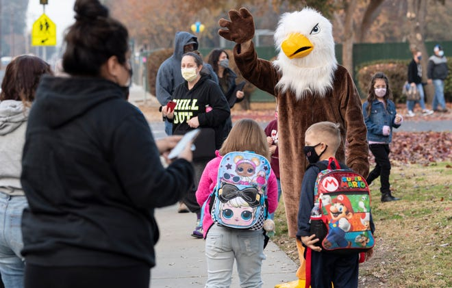 Pinkham mascot Eddie the Eagle greets Pinkham Elementary School students returning to classrooms Monday, December 7, 2020. Visalia Unified School District leaders have said they are adhering to federal health protocols.