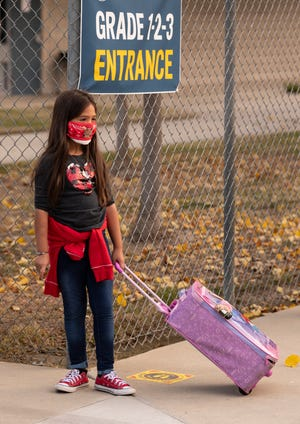 Some Pinkham Elementary School students returned to classrooms Monday, December 7, 2020. Visalia Unified School District leaders have said they are adhering to federal health protocols.
