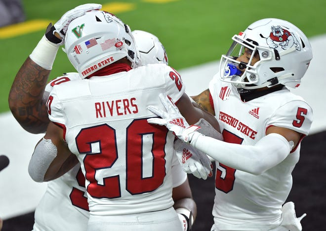 Nov 7, 2020; Paradise, Nevada, USA; Fresno State Bulldogs running back Ronnie Rivers (20) celebrates with Fresno State Bulldogs wide receiver Jalen Cropper (5) after scoring a touchdown against the UNLV Rebels during the first half at Allegiant Stadium. Mandatory Credit: Stephen R. Sylvanie-USA TODAY Sports