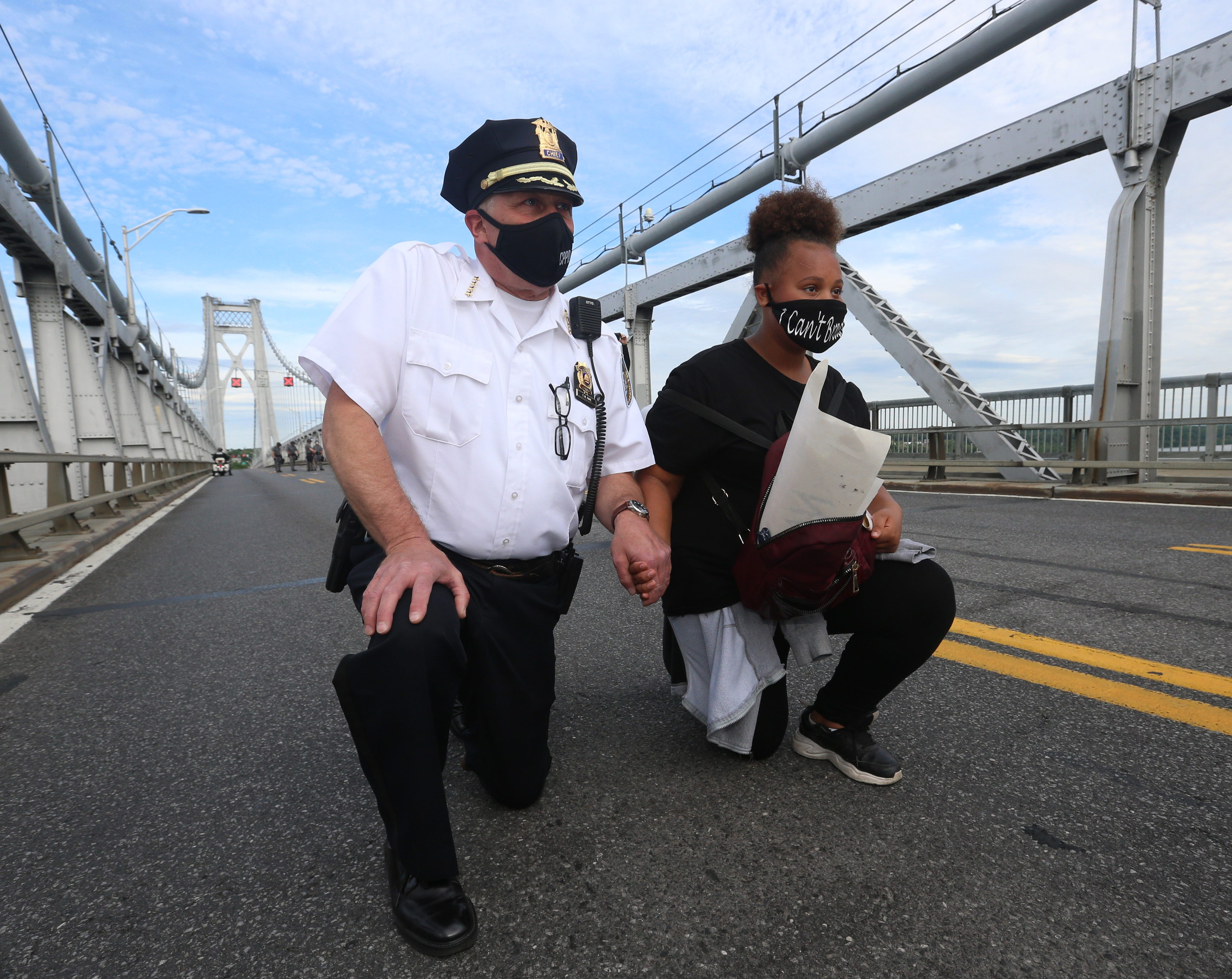 At the height of the coronavirus pandemic across the nation, New Yorkers took pause with the rest of the country to stand for racial justice. Here City of Poughkeepsie Police Chief Thomas Pape kneels with protestor Olivia Mima-Canada on the Mid-Hudson Bridge during a June protest.