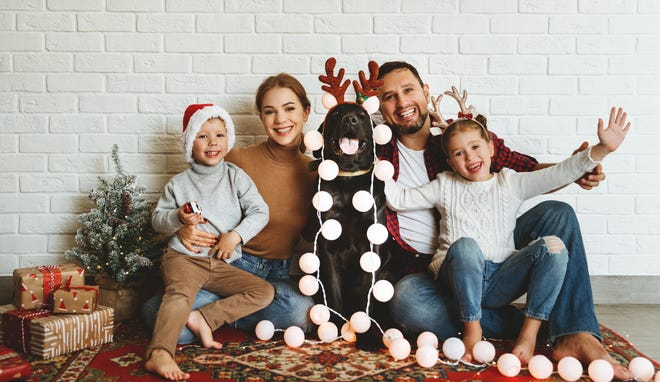 A family photo can be fun and celebrate the season with some very simple props.