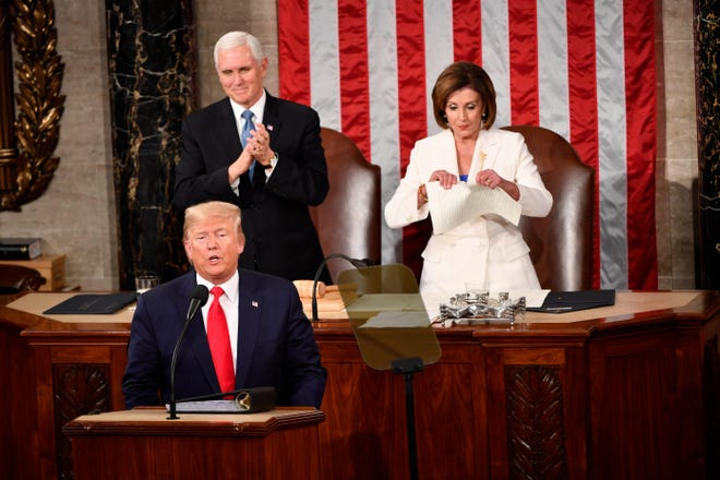 Speaker of the House Nancy Pelosi rips up the speech after President Donald J. Trump concludes delivering the State of the Union address from the House chamber of the United States Capitol in Washington on Tuesday, February 4, 2020.