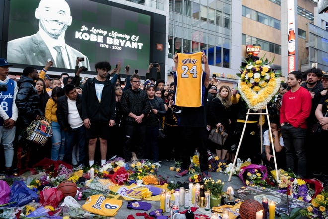 Fans gather at L.A. Live to pay their respects to former Los Angeles Lakers guard Kobe Bryant and his daughter Gianna, who died along with seven other people in a helicopter crash on January 26, 2020.