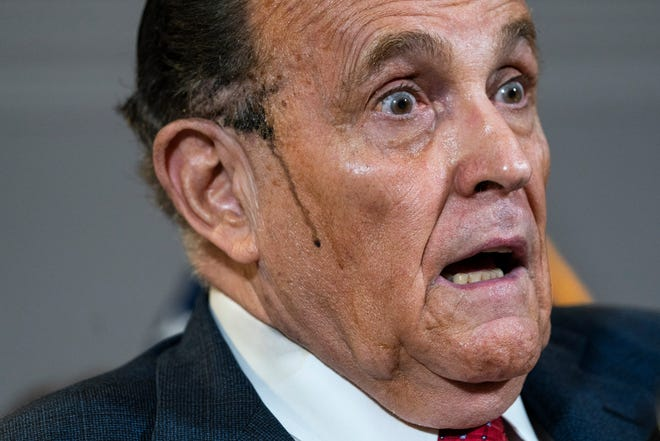 Rudy Giuliani speaks to the press about various lawsuits related to the 2020 election, inside the Republican National Committee headquarters on Nov. 19, in Washington, D.C.