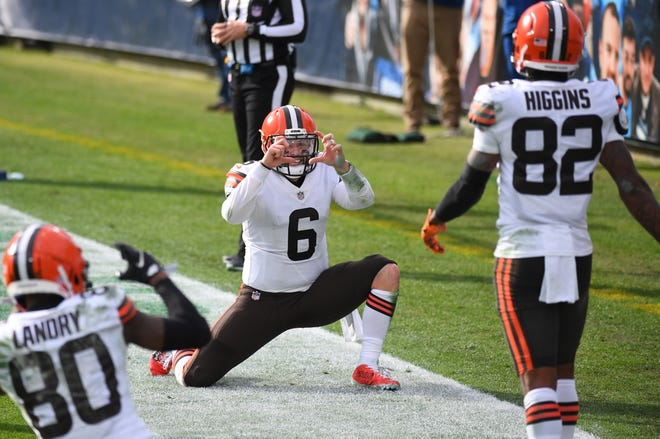 Cleveland Browns quarterback Baker Mayfield  celebrates with wide receivers Jarvis Landry (80) and Rashard Higgins (82) after Higgins scored against the Tennessee Titans. [Christopher Hanewinckel/USA TODAY Sports]
