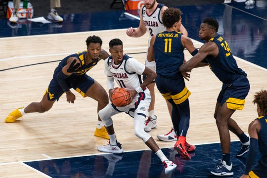 Gonzaga guard Joel Ayayi (11) spins to shoot the ball against West Virginia during the first half at Bankers Life Fieldhouse.