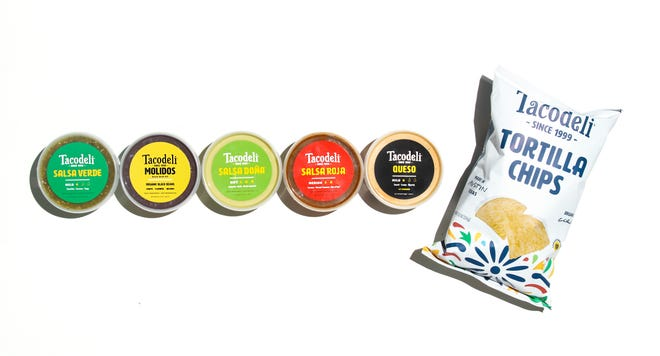 Tacodeli's grocery line now includes tortilla chips and molidos, the pureed black beans that are a customer favorite.