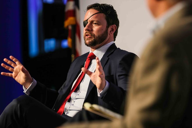 U.S. Rep. Dan Crenshaw, R-Houston, shown speaking in January, has recently called for new voter ID requirements and a crackdown on mail-in voting. [LOLA GOMEZ / AMERICAN-STATESMAN]