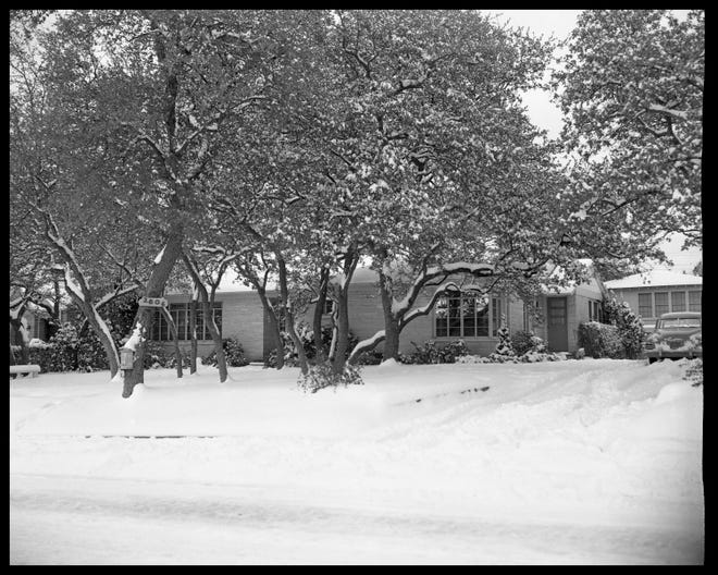 A rare scene of snow in Austin: 2806 Enfield Road in Tarrytown, as captured by photographer Neal Douglass on Jan. 30, 1949.