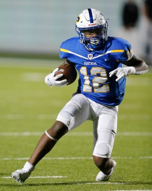 Pflugerville running back Jake Iloka, running with the football against Weiss in November, is part of a one-two Panther running back combination with Elijah Oakman that has helped the Panthers reach the playoffs.