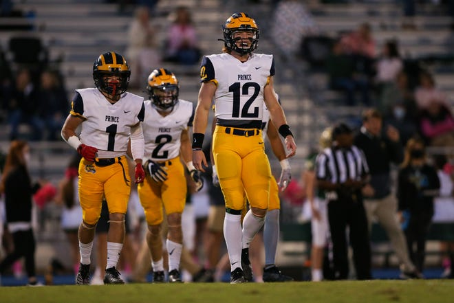 Prince Avenue's Brock Vandagriff (12) takes the field during the first half of a game this season. (Photo/Carmen Mandato for the Athens Banner-Herald)