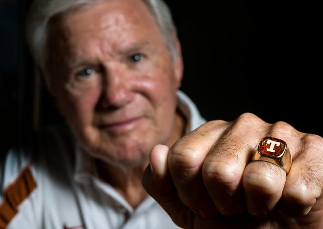 Former Texas football coach Fred Akers poses for a portrait with his T-ring in September 2015, just before he was inducted into UT's men's hall of honor. The coach who replaced the legendary Darrell Royal died Monday. He was 82.