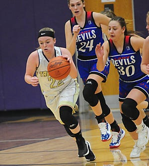 Sebring McKinley's Emma Whaley starts a fast break in a Mahoning Valley Athletic Conference game against Western Reserve Monday, December 7, 2020.