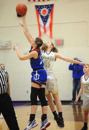 Western Reserve's Danielle Vuletich, left, shown in an earlier game, led the Blue Devils over Louisville on Monday night with a 19-point performance.