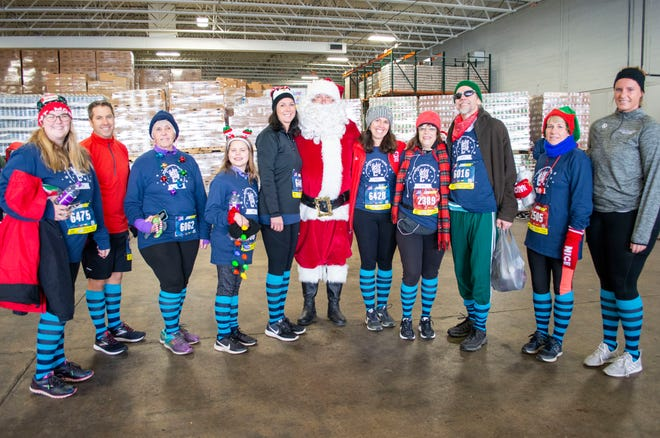 Runners of the 2019 Selfless Elf gather together to show off their stylish elf socks.