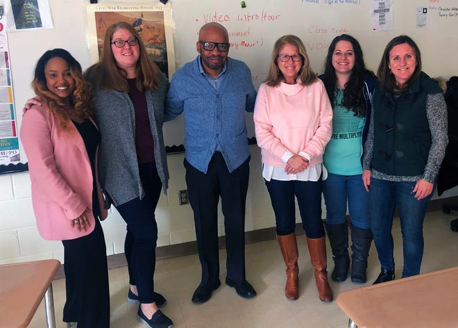 Rancocas Valley Regional High School history teachers Neshea Thomas and Cheryl Alspach, left, pose for a picture with Timbuctoo Historical Society President Guy Weston, center, and Westampton Middle School history teachers JoAnn Donnelly, Cristina Burrows and Jennifer Perry, right.