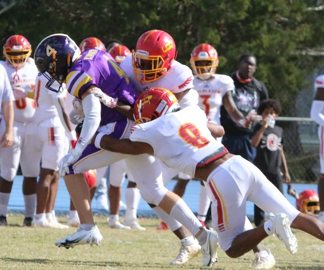 South Beauregard's Cale Jacobsen (4) struggles for more yardage during a Golden Knights contest recently. SBHS fell to Lake Charles Prep on Saturday in the Class 3A playoffs.