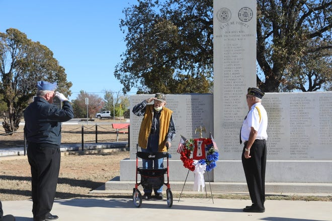 Harold Stieber, representing the American Legion Post 196, World War II veteran  Gussie Sieler of May and retired Army Col. Tom Gray, Commander of the American Legion Post 196, commemorate Pearl Harbor Day Monday at the Central Texas Veterans Memorial.