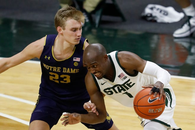 Notre Dame guard Dane Goodwin, here defending Michigan State guard Joshua Langford, is averaging 13.5 points and 9.0 rebounds per game for the Fighting Irish in his junior season.