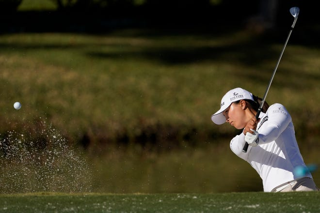 Jin Young Ko hits out of a bunker on the 11th hole during a practice round for the U.S. Women's Open golf championship.