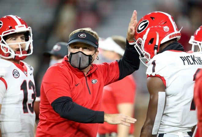 Georgia head football coach Kirby Smart talks to wide receiver George Pickens (1) before a game against Alabama on Oct. 17 at Bryant-Denny Stadium in Tuscaloosa, Ala.
