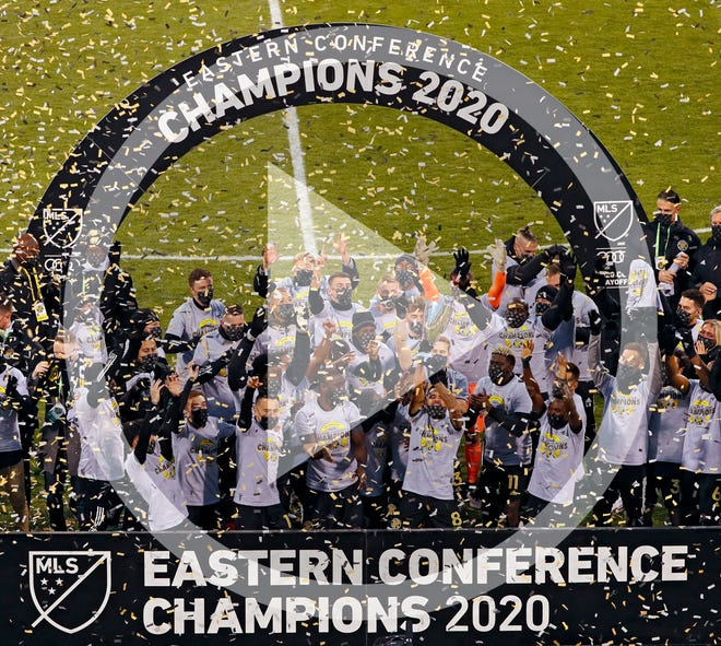 In this file photo, Columbus Crew SC midfielder Artur (8) who scored the game winning goal hoists up the Eastern Conference trophy after beating New England Revolution 1-0 in the MLS Eastern Conference Final at MAPFRE Stadium in Columbus, Ohio on December 6, 2020.