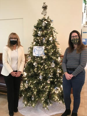 Tammy Smith and Melissa Goonan, of Peoples Bank (Main branch), with Hospice Memorial Dove Trees.