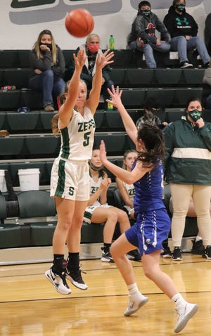 Shenandoah freshman Mya Leach lets loose with a jump shot over Braxton King of Cambridge during Monday's game in Sarahsville.