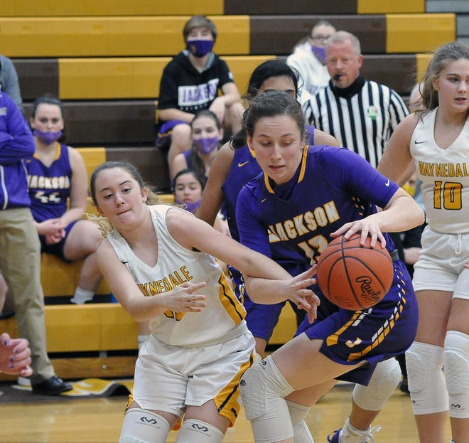 Waynedale's Cherlyn Miller and Jackson's Emma Dretke battle for this rebound. Dretke had a game-high 23 points in Jackson's win over the Golden Bears.