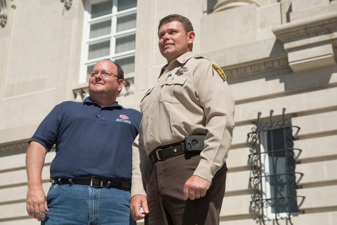 District Attorney Brent Cooper and Maury County Sheriff Bucky Rowland stand outside of the Maury County Courthouse following a walk in  observance of National Crime Victims' Rights Week on Friday, April 20, 2018. (Staff photo by Mike Christen)