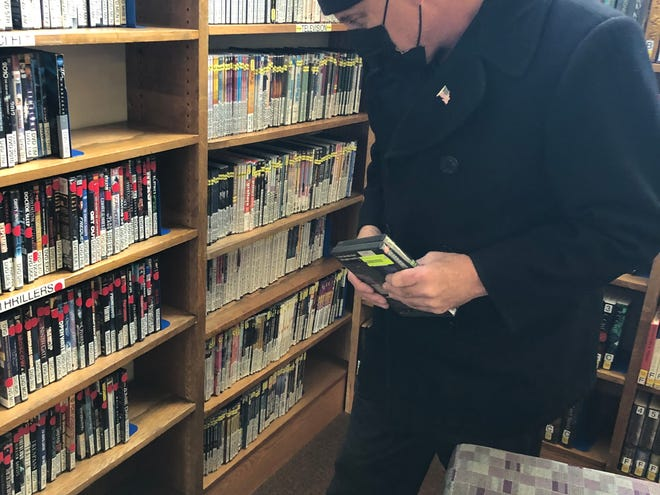Chris Carter browses the Hornell Public Library's films collection in the new DVD room. The library reopened Monday after closing for approximately nine months.