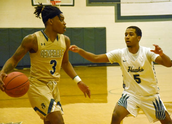 Mohawk Valley Community College Hawk Justin Steed (5) defends against Herkimer College General Shykell Brown (3) during the Region III championship game in Utica March 1. Neither school will be playing basketball this winter as they are among 27 SUNY community colleges that have canceled high-risk indoor winter sports because of the coronavirus pandemic.