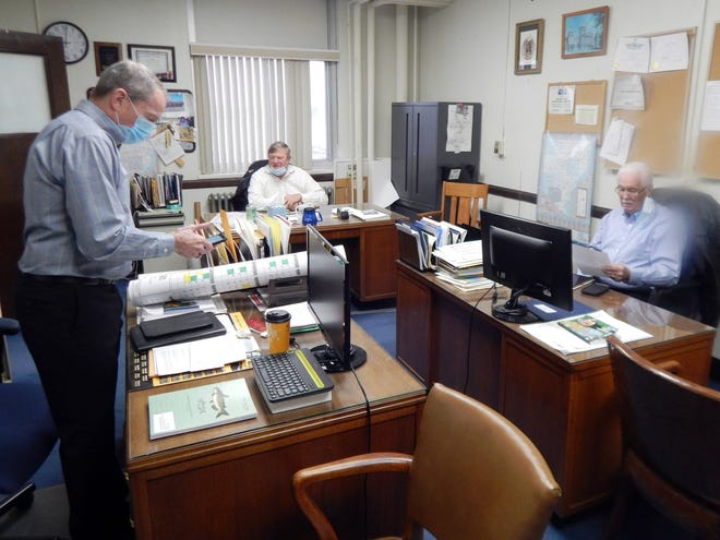 From left, Des Moines County supervisors Tom Broeker, Bob Beck and Jim Cary prepare for their regular board meeting Tuesday inside the supervisors office in the Des Moines County Courthouse.