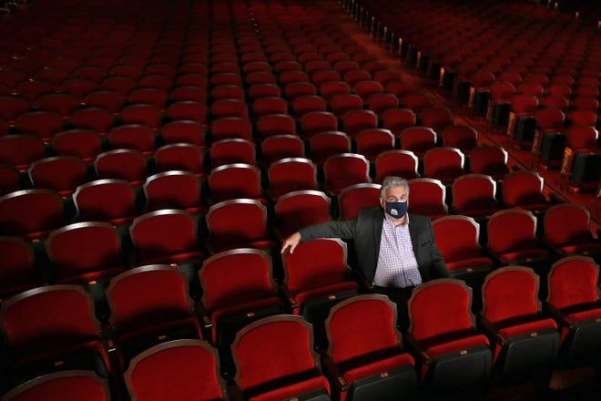 Numa Saisselin, president of the Florida Theatre, sits in the currently empty venue Tuesday in downtown Jacksonville. After going dark for concerts because of COVID-19 and taking advantage of the opportunity to redo all the theater's seating, the historic venue restarts live shows with precautions and spectator limitations this week.
