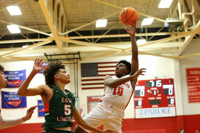 Hendersonville's Dwight Canady (10) shoots the ball against East Lincoln during last year's playoff game at Jim Pardue Gymnasium.