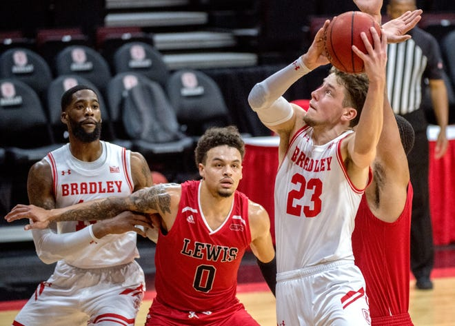 Bradley's Ville Tahvanainen (23) moves to the basket against Lewis in the first half Monday, Dec. 7, 2020 at Carver Arena. The Braves defeated Lewis 95-62.