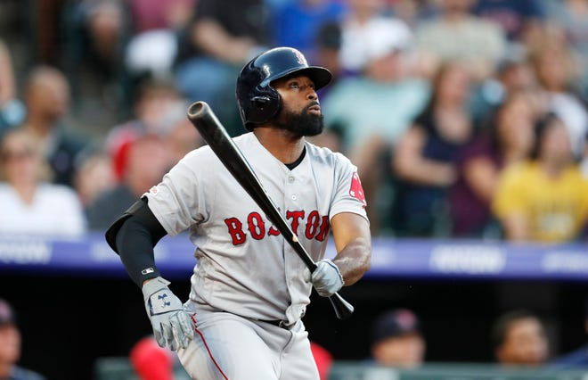 Boston Red Sox's Jackie Bradley Jr. watches his solo home run off Colorado Rockies starting pitcher Rico Garcia during the second inning of a baseball game Tuesday, Aug. 27, 2019, in Denver.