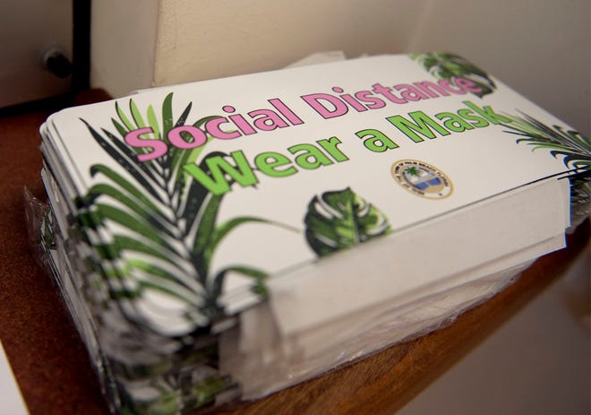 """Palm Beach branded car magnets with the message """"Social Distance, Wear a Mask"""" were available in August."""