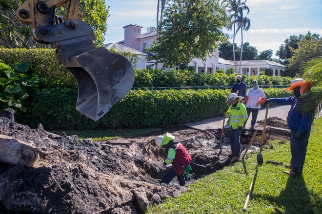 Contractors work on a section of the Lake Trail near Tangier Avenue as the town investigates an issue with a sanitary sewage pipe on Tuesday.
