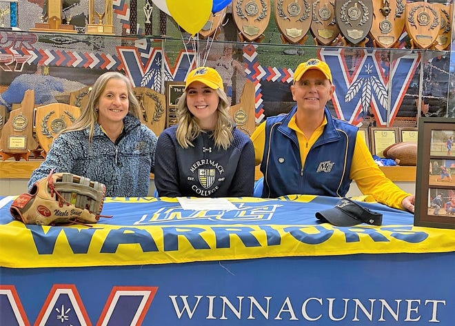 Winnacunnet High School senior Nicole Basil, center, sits with her parents, Joanne and Steve, during Saturday's National Letter of Intent signing. Basil will play softball at Merrimack College, a Division I program in North Andover, Mass.