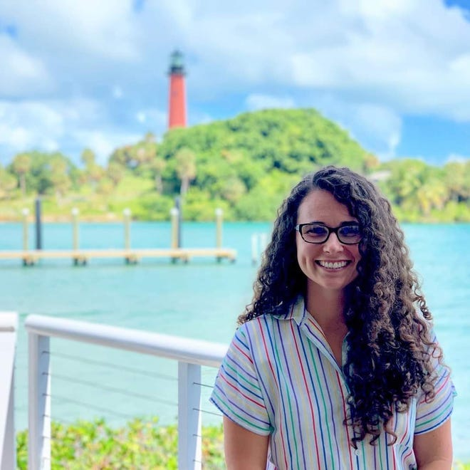 Maria Tritico poses in front of the Jupiter Lighthouse in this undated photo. Tritico, 32, died Dec. 7 after she was shot on Singer Island the day before.