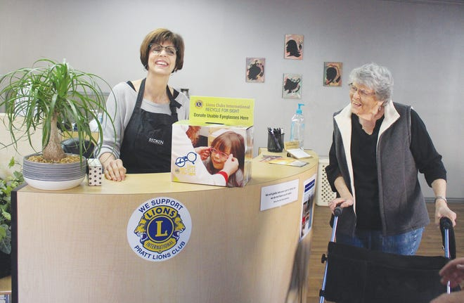 Leisa Eck, at Blades Hair Studio, 105 E. Fifth, discusses where to put the new Pratt Lions Club eye-glasses collection box with her mother, Arlynn Baker, Monday at the shop. New boxes are out at several locations around town. Raffle tickets are also available at this time for the Lions Club annual Christmas raffle, supported by many Pratt businesses. Contact info. in the story for those wanting to get tickets.
