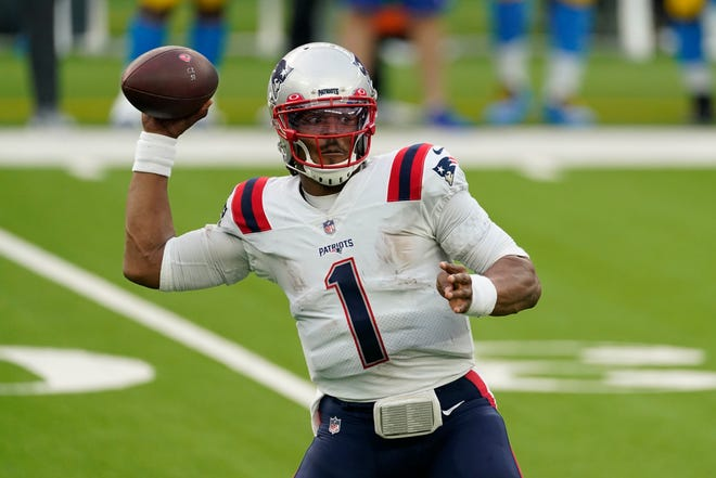 Patriots quarterback Cam Newton throws a pass against the Chargers during Sunday's game. Newton completed 12-of-19 passes for only 69 yards but New England still won, 45-0.