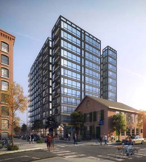 A rendering of the 12-story apartment and retail building proposed at 151-155 Chestnut Street in Providence. [Courtesy of Pebb Capital]