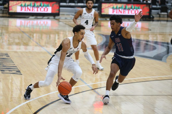 Providence's Brycen Goodine looks to drive against a Fairleigh Dickinson defender on Dec. 5 in Alumni Hall. The Friars will visit TCU on Wednesday afternoon.