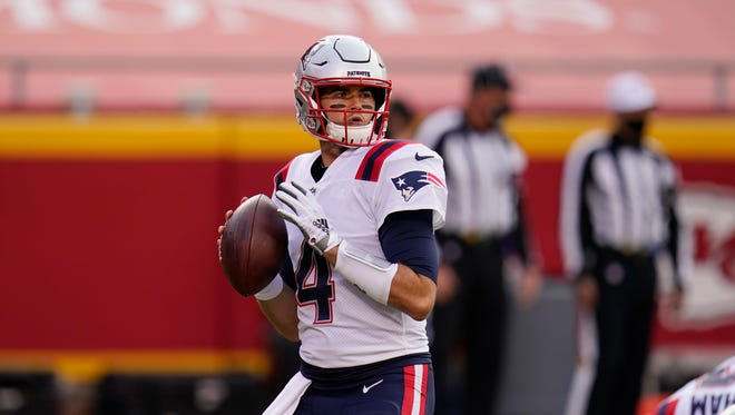 Patriots quarterback Jarrett Stidham warms up before a game against the Kansas City Chiefs earlier this season.