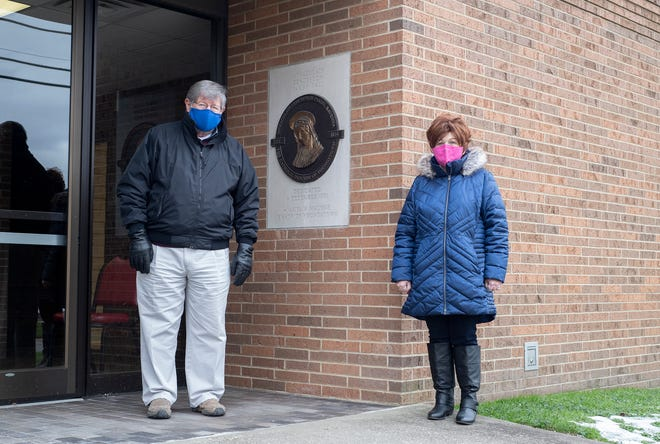 Chuck Calalesina, business manager for Immaculate Conception, and Anne Marie Noble, executive director for The Haven of Portage County, outside of the Immaculate Conception Hall at 251 Spruce St. The Hall will be used as a warming center when the temperature drops below 20 degrees.