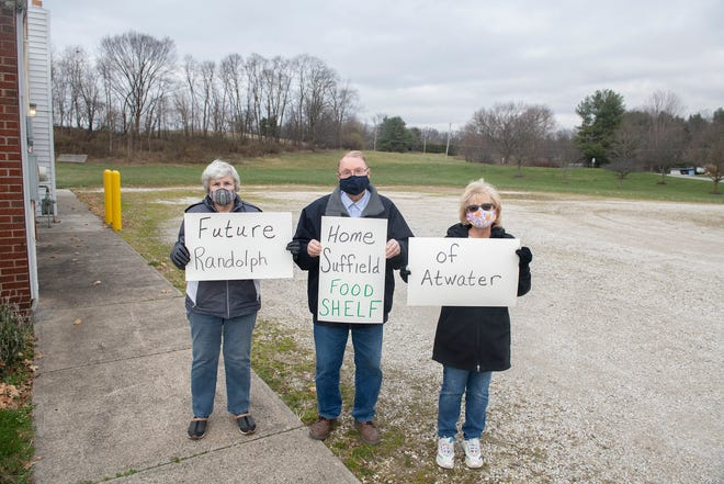 The Randolph Suffield Atwater Foodshelf is building a new place for its operations on the Knights of Columbus building property on Waterloo Road. The building will take a portion of the parking space of the Knights of Columbus. RSA Foodshelf directors from left, Joan Trautman, Gary Harrison and Diane Jones hold signs on the property.