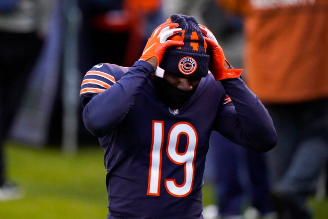Chicago Bears receiver DeAndre Carter walks off the field following a 34-30 loss to the Detroit Lions in Chicago on Sunday, Dec. 6, 2020.
